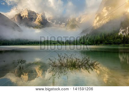 Beautiful Mountains Lake at the misty morning. Nature Landscape. Lago di Landro Durrensee, Dolomites, Alps, Italy, Europe.