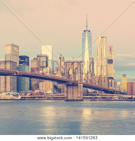 New York City - sunrise view of Manhattan with skyscrapers  and famous Brooklin Bridge, vintage retro colors