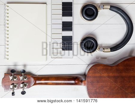Music Writing Instruments. Music Technology on wooden desk
