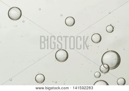 Nice big air bubbles soars over a blurred background