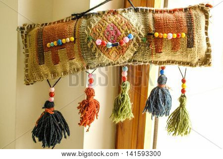 Cushion with beads and tassels and motives of Turkey