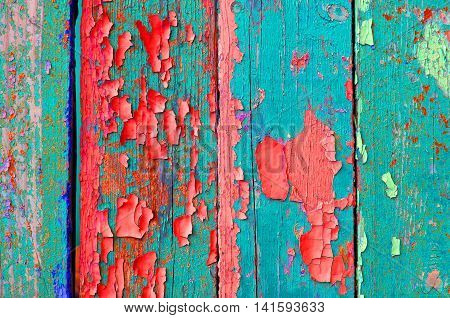 Textured wooden background of old wooden painted green and red textured planks with peeling paint