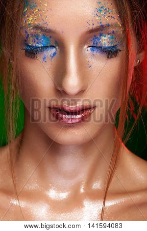 Woman with powder on face in creative make up style. Beauty portrait. Close up in studio with big eyelashes