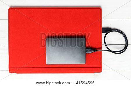 USB External hard disk on Red tablet computer