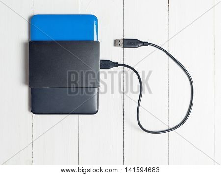 USB External Hard disk tacked on wooden background