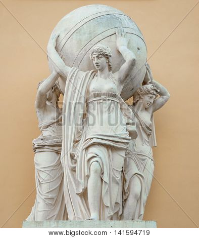 Sculptures Caryatids that hold globe adorns the antique building