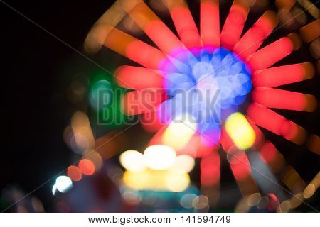 Amusement park ferris wheel light night blurred for background