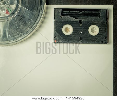 Film and Video Cassette on vintage paper background