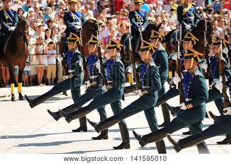 Orel Russia - August 05 2016: Orel city day. Marching and horse guards in front of crowd of people horizontal