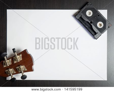 Guitar Head with Video Tape on white paper with space.