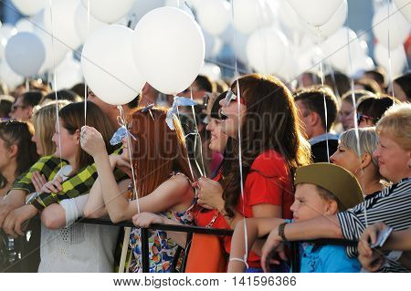 Orel Russia - August 05 2016: Orel city day. Girls with white ballons closeup