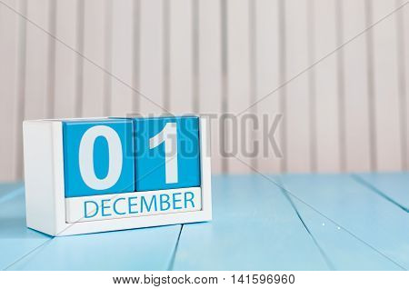 December 1st. Day 1 of month, calendar on wooden background. Winter time. Empty space for text.