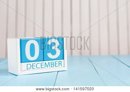 December 3rd. Day 3 of month, calendar on wooden workplace background. Winter time. Empty space for text.