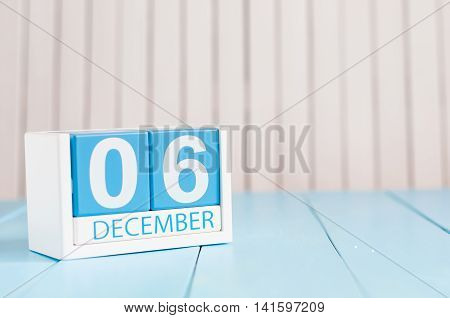 December 6th. Day 6 of month, calendar on wooden background. Winter time. Empty space for text.