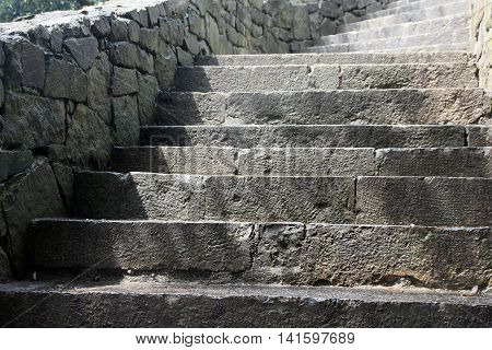 beautiful old stone stairs natural dark stone diabase with stone steps in summer park outside in Crimea