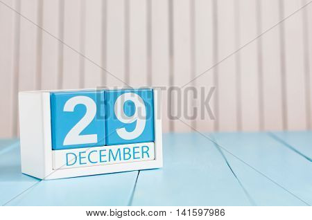 December 29th. Day 29 of month, calendar on wooden background. New year at work concept. Winter time. Empty space for text.