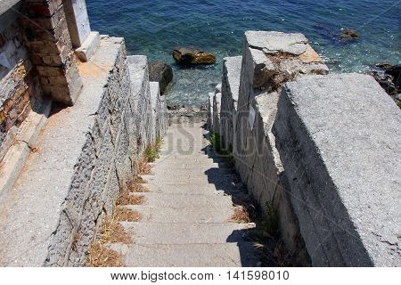 old stone staircase descends to the rocky sea coast of Black sea in Crimea