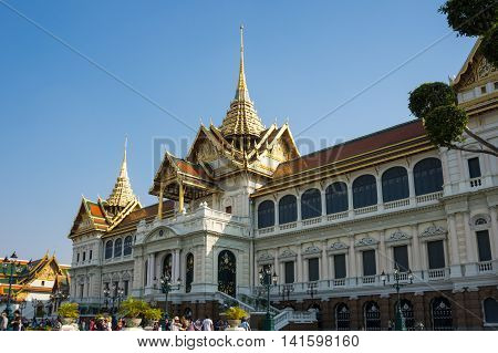BANGKOK THAILAND - JANUARY 24 2015: Unidentified tourists visit the Grand Palace in Bangkok Thailand. Grand Palace in Bangkok is the most famous landmark of Thailand