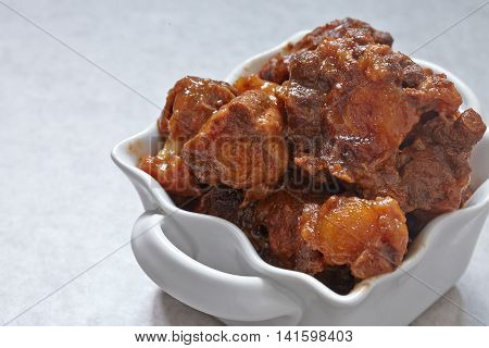 Barbeque beef oxtails tails stew on a table