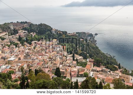Aerial view of Taormina and Mediterranean sea seen from Castelmola Sicily