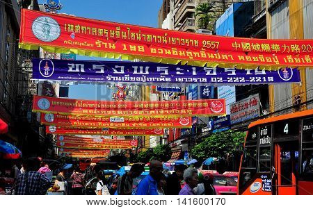 Bangkok Thailand - January 18 2014: Chinese Lunar New Year banners stretch across bustling Yaoworat Road in Chinatown *