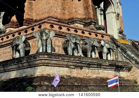 Chiang Mai Thailand - January 4 2013: A row of five stone elephants stands on the first level of 1401 brick Wat Chedi Luang