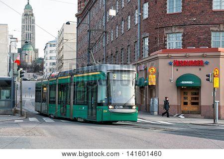 HELSINKI FINLAND - MART 31 2012: Modern tram on the streets of Helsinki