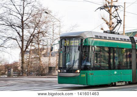 HELSINKI FINLAND - MART 31 2012: Modern tram on the streets of Helsinki. Woman driver leads the tram route 7A
