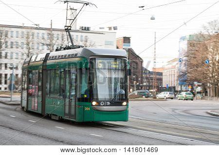 HELSINKI FINLAND - MART 31 2012: Modern tram on the streets of Helsinki.