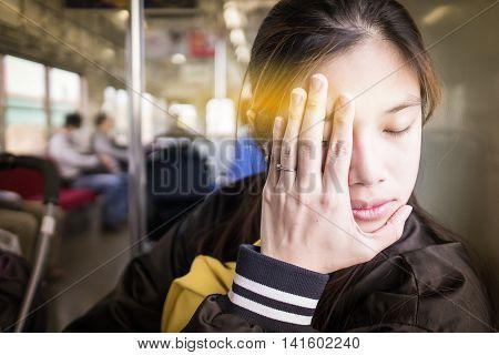 Asian girl having travel sickness on a train