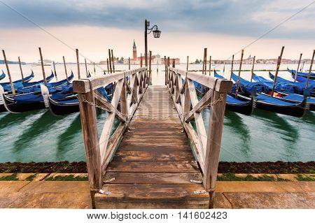 View of the Church of San Giorgio Maggiore and marina with gondolas in the morning. Venice. Travel Italy.
