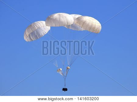 Dropping cargo using military parachute system before landing