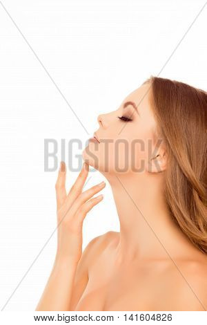 Side View Portrait Of Beautiful Sensitive Woman Touching Her Neck