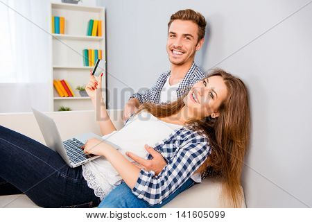 Man And Woman Making Internet Shopping With Laptop And Credit Card