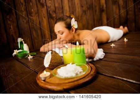Portrait of sensual pretty woman relaxing on aromatherapy