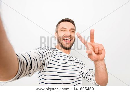 Happy Cheerful Laughing Man Making Selfie And Showing Two Fingers