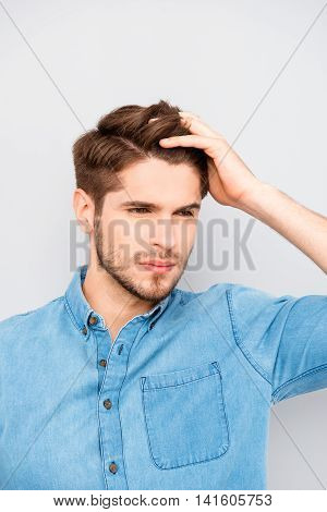 Handsome Man Touching His Hair Isolated On Gray Background
