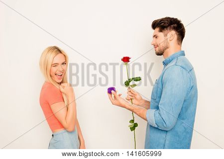 Portrait Of Happy Woman And Man Holding Rose And Box With Wedding Ring