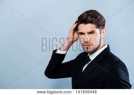Portrait Of Confident Sexy Businessman Touching His Hair