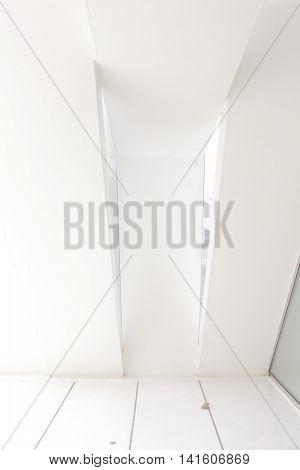 An irregular white wall where the light hits