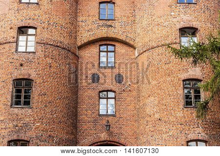 Detail of old brick gate to fortification in Frombork - Poland.