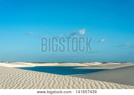 Lagoons in the desert of Lencois Maranhenses National Park Brazil low flat flooded land overlaid with large discrete sand dunes with blue and green lagoons