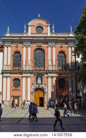 MUNICH, GERMANY - AUGUST 29, 2015: The Buergersaalkirche (Citizen's Hall Church) was built in 1709 and is a historical building in the inner city of Munich unidentified people are passing by