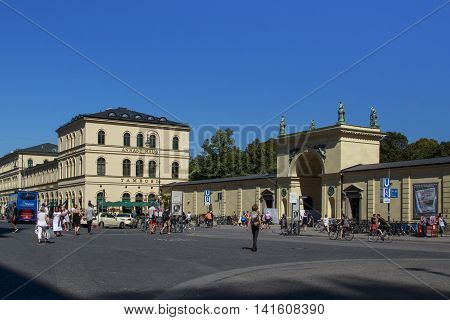 MUNICH, GERMANY - AUGUST 29, 2015: The Odeonsplatz in the inner city of Munich with its large square and unidentified people are passing by
