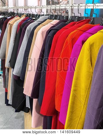 Multi-colored Coat Hanging On Hangers.
