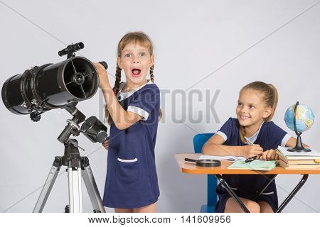 Girl Surprised Astronomer Observing Through A Telescope, The Other Girl Looked At Her