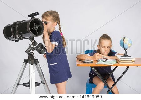 Girl Watching The Celestial Bodies In The Telescope, The Other Girl Is Waiting For The Results Of Ob