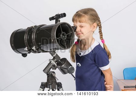 Girl Amateur Astronomer Watching The Stars Through A Telescope