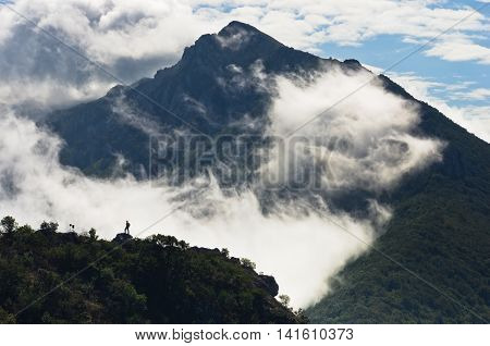 Mountain peaks of Suva Planina at morning covered with clouds in east Serbia