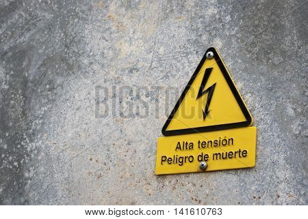 Signboard of danger high voltage in spanish text